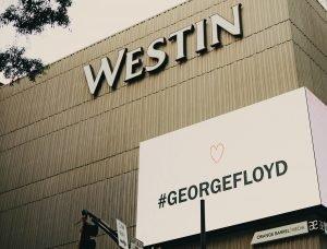 Westin hotel sign displays #GEORGEFLOYD hashtag.